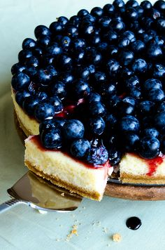 Light Blueberry Cheesecake with cream cheese and Greek yogurt. This will be your ultimate cheesecake recipe. Just change the topping for your taste! | giverecipe.com | #cheesecake #blueberries #berries #dessert #summer #creamcheese #greekyogurt #cheesecakecrust