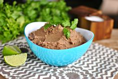 Refried beans from scratch is made easy by using the slow cooker. Easy to throw together, cooked all day making these the best (non) refried beans in town.