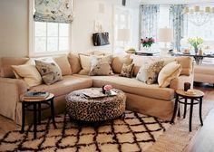Moroccan rug, leapord print ottoman, small tables...love this room.