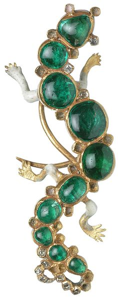 Emerald, gold, and diamond hat pin in the shape of a salamander, Found with the Cheapside Hoard in 1912, a collection of Elizabethan and early Stuart era jewelry on display at the Museum of London until 4/14. 16th- early 17th century