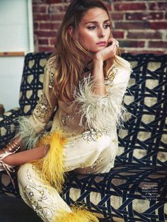 Taking a seat, Olivia Palermo models Prada pajama style top and pants