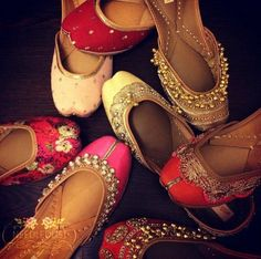 Collection of Juttis by #needledustjutti Golden juttis made of raw silk and embellished with pearls on raw silk.  Find more Indian ethnicwear and wedding designs at #www.jivaana.com