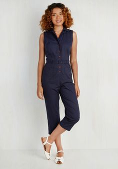 Album Cover to Cover Jumpsuit. At the shoot for your upcoming EP, you fasten the wooden buttons of this navy jumpsuit and are ready for your close-up! #blue #modcloth