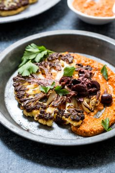 Cauliflower Steaks with Spicy Romesco Sauce | girlinthelittleredkitchen.com