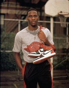 Jordan with his first pair of Nikes. Look at how young he was.