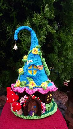 This is a new handmade crochet Fairy / Gnome house. Made with colorful acrylic yarns it is decorated on all sides. This house stands approx. 14 inches