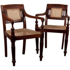 India  late 19th century early 20th  Pair of Anglo-Indian rosewood chairs with flute carving on backrest and arms. Front turned legs, newly caned seat and back