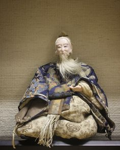 This wise old counsellor doll holds court at the Mingei Iyo Kasuri Kan  #doll #Matsuyama #kimono