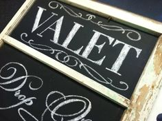 Valet Drop Off: hand-lettered chalkboard signage in an antique window frame