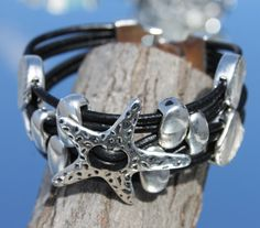 wide black multistrand Bracelet with starfish von myDemimore