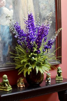 A stunning vase of purple delphiniums, unbrella fern and green bell. We lined the inside of the vase with moss to give a natural look. #reidsflorists