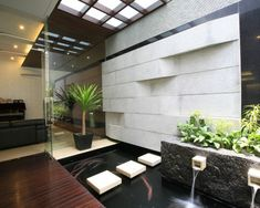 Indoor water feature - interesting light source from opaque glass above