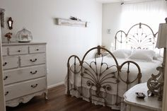 This French farmhouse-style bedroom designed by blogger burlapluxe.blogspot.com for her daughter captures the romance and beauty of embracing pieces of old that magically come together to create a romantic sleeping quarters.