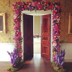 Victoria and Belal's wedding and St Giles House - floral arch by West Dorset Wedding Flowers.
