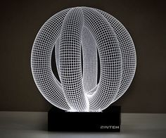These desktop lights are fast becoming 2015's favorite double-Ds. It's LED meets 3D when the bulbs are positioned to glow through a grid mapped out on a thin slice of laser-cut acrylic glass. The optical illusion burns bright as intertwined Balby Ri