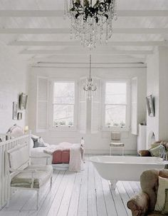 All white beautiful master bedroom.
