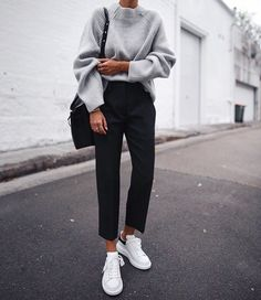 Casual fall womens outfit. Grey knit sweater and black trousers.