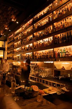Bottle storage/display ; use ladder - Rickhouse whiskey bar...San Francisco