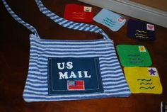 Props for mail carrier dramatic play: real envelopes, stationary, pencils, mail box, mail bag, and maybe something for them to wear