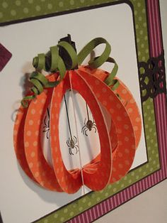 So clever. Punch 4 circles. Punch out smaller circle from middles. Stack circles & shape into 3D pumpkins. Trim with curled paper strip vines. Could use same idea to make 3D Christmas balls or other spherical shapes.