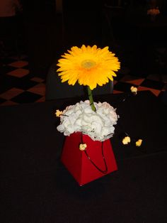 """Popcorn table centerpieces for a movie themed """"ready to pop"""" baby shower"""