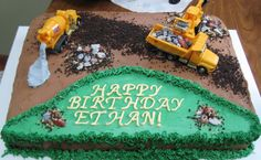 """construction scene birthday cake - 11 x 15 sheet cake, chocolate buttercream and white buttercream icing,  #233 tip green grass,  chocolate candy """"rocks"""" in piles, in dump truck, and in front loader,  chocolate """"crunchies"""" for dirt road and in piles,  tinted small amount of stiff buttercream grey for cement coming out of the back of cement mixer, trucks are light-weight plastic, fully functional and are secured to cake with a dab of buttercream to bottoms"""