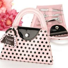 """Add some cosmopolitan flair with these manicure sets fashioned to look like ultra-chic purses! The 4 piece stainless steel set includes nail file, scissors, clippers, and tweezers and fits perfectly in the pink and black polka dot purse. A charming purse shaped thank you tag adds to the presentation. Measures 5 1/8"""" x 5 1/2""""."""