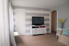 Gray Striped Wall in our bedroom? Only concerned the color may make us feel gloomy like Eeyore.  But love the look of it!
