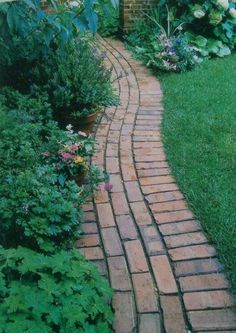 Nice brick edge / border that also serves as a path. Curved and doesnt require cutting bricks.