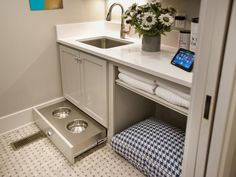 - Laundry Room Pictures From HGTV Smart Home 2014 on HGTV. Pet bed area perfect for my kitty litter box.