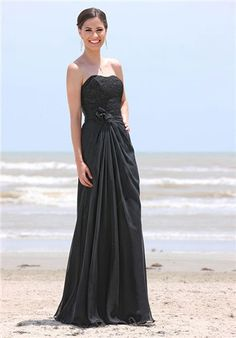 Chiffon gown with pleated empire waist.  Gathering at flower detail extends into long flowing a line skirt.  Lace bodice with sweetheart strapless neckline.