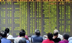 Chinese investors sit in front of a screen showing market movements in a stock firm in Hangzhou, eastern China's Zhejiang province on July 8, 2015.