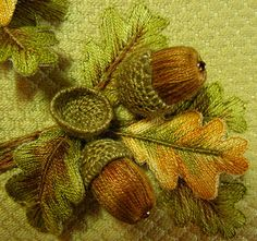 Stumpwork acorn and oak leaves by Wildflower Embroidery ...stump work is 3-D embroidery ...a base of 2-D flat stitches , padded stitches start the 3rd dimension and then a wired or structured element