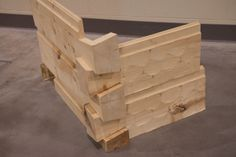 "Kiln Dried Eastern White Pine 2""x12"" Square Log Siding w/ Chink Slot, Hand Hewn finish, and false dovetail corners"