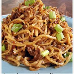 Szechuan Noodles With Spicy Beef Sauce Recipe Main Dishes with ground beef, onions, minced garlic, fresh ginger, crushed red pepper, sesame oil, corn starch, beef broth, hoisin sauce, soy sauce, chinese noodles, sliced green onions