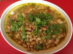 5 Stars - Charro Beans. Pretty darn good. Just the right balance of heat in my opinion.  6 cups of dried pinto beans 24 oz Mexican beer (Corona Extra) ½ bunch fresh cilantro (chopped) 2 Tblsp minced garlic (fresh) 2 Tblsp sea salt 1 lb bacon  2 cans rotel 14 cups chicken broth Large onion 2 large jalapenos (seeded & diced)  Prepare your beans according to package directions. Combine with the above ingredients and cook accordingly.
