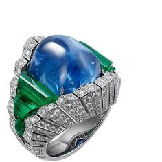 """Originelle"" platinum ring from @cartier set with a 32.35 carat hexagonal shaped #cabochonsapphire, #roughemeralds and #brilliantcut diamonds. @jewellerymaven."