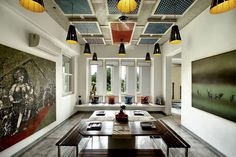 Dining area with colorful ambiance .Wooden ceiling with hanging elements .