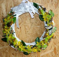 Wicker wreath with a yellow flower accent and little by Skygriffin