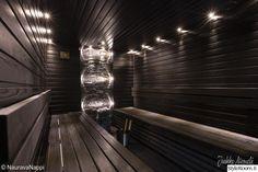 sauna,musta,kiviseinä,kiuas,led-valot