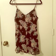 Floral romper Romper with Ruffles at the bottom. Adjustable straps and zips in the back. Tiny spot in the back where the stitching came loose. Hardly noticeable Honey Punch Pants Jumpsuits & Rompers