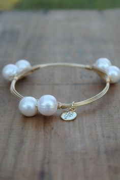 Off the Racks Boutique - Bourbon and Boweties: Double Pearl Bangle, $32.00 (http://www.shopofftheracks.com/bourbon-and-boweties-double-pearl-bangle/)