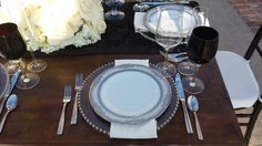 These are our Vanessa Platinum Dinner plates put to action, together with the Silver beaded chargers, white napkins, Lucca faceted flatware, Pure wine glasses , and our brand new black wine glasses. Coordinator: La Boheme Events, Florals by Butterfly Foral.