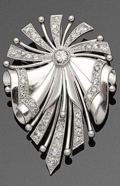 An Art Deco white gold and diamond brooch / pendant. Designed as a stylised flower tied by a ribbon bow, set with old-cut diamonds weighing approximately 1.70 carats. Can also be worn as a pendant. #ArtDeco #brooch #pendant