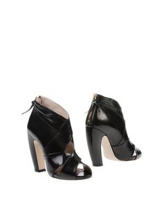 I found this great MIU MIU Ankle boot for $367 on yoox.com. Click on the image above to get a code for Free Standard Shipping on your next order. #yoox
