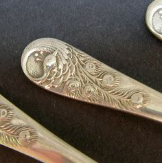 Electroplated silver (EPNS) spoons with Peacocks. (Butterflymindvintage/Etsy)