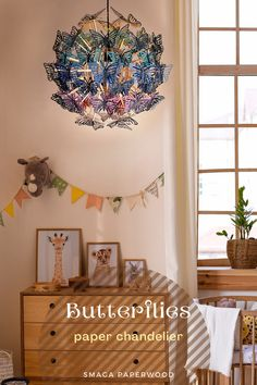 Large 60 cm / 23.6 in diameter chandelier lighting with paper butterflies in rainbow colours.We use thick ( 280-300gsm ) Italian card with a delicate sheen, and FSC certified plywood. This paper