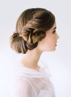 Romantic side swept bridal updo