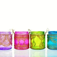 Set of Four Moroccan Lantern Votive Holders- In Fuschia, Purple, Turquoise, and Green Glass with Golden Details. $45.00, via Etsy.