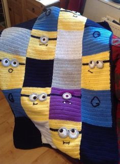 Crocheted Minion Blanket  No pattern, just DC rectangles and faces copied from various you tube videos.